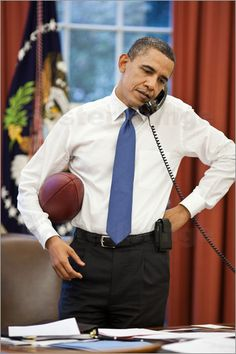 """""""President Barack Obama talks on the phone with House Speaker John Boehner in the Oval Office, April """""""
