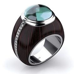 How unique and cool is this ring by @markinjewellery ? Made of ebony wood and white #gold and set with a #tourmaline in the center and accented with #diamonds