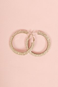 Add a little sparkle to your day with these earrings.  The Iris Hoop earrings are a circular with rhinestone embellishments.  www.brillantezza.com