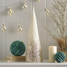 Our Champagne Ombre Cone Trees (20 in. and 24 in.) keep it current with a beautiful metallic ombre design. Display on your mantel or bookshelf for a little extra sparkle and pizzazz.