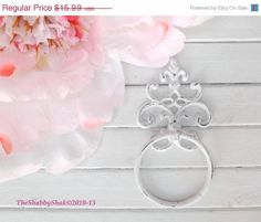 Ornate scrolled towel ring. Fleur de lis pattern Cast iron fixture hangs with 2 screws into wall (not included). Paint adhesion promoter is used