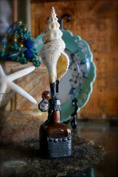 Rustic Sea Shell Upon Amber Glass Vessel Topped by tresorbleu, $98.00