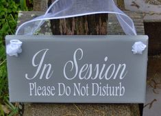 "In Session Please Do Not Disturb Wood Vinyl Sign Door Hanger 9""x4.5"" gray sign with white lettering and sheer white ribbon.... ask us how we can personalize it for you."