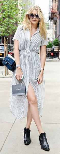 Gigi Hadid slays in a simple pinstripe shirt dress with a simple slit! See…