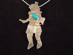 Sterling Silver Kachina with Turquoise  by Burnedbunnybling