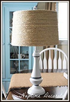 20 DIY Lamp Makeovers Super easy diy project for my boys nautical room…some jute, old lamp shade, and my hot glue gun :] Nautical Lamp Shades, Nautical Lamps, Nautical Nursery, Nautical Interior, Nautical Theme, Bedroom Lamps Design, Lamp Design, Bedroom Lighting, Old Lamp Shades
