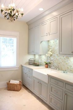 Villa Decor - laundry/mud rooms - laundry room cabinet, gray cabinets, gray laundry room cabinets, cream counters, cream countertops, glass ...