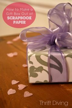 How to make a Gift Box Out of Scrapbook Paper  Works pretty well. Try to be precise in your measurements or you get a parallelogram instead of a true square.