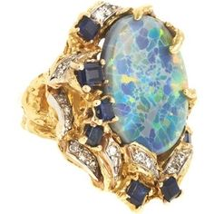 Chartreuse Opal King Arthur Ring; 18k gold sculpted ring. Opal center stone with surrounding sapphire and diamond settings.