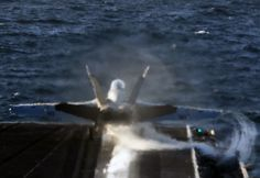 An F/A-18F Super Hornet assigned to the Bounty Hunters of Strike Fighter Squadron (VFA) 2 launches from the flight deck of the Nimitz-class aircraft carrier USS Abraham Lincoln (CVN 72).