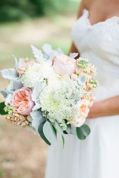 A gorgeous whimsical bouquet of garden roses, chrysanthemums, stock, Queen Anne's lace, dusty miller and eucalyptus. {Brooke Images}