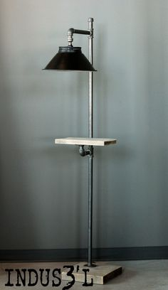 Lampe sur pied sur mesure. Création La Shop de Design https://www.facebook.com/lashopdedesign http://lashopdedesign.com #industrial #industriel #wood #reclaimed #recycled #pipes #metal #furniture #lighting #floorlamp #lamp #livingroom #lashopdedesign #ladesignshop #designerpourvrai