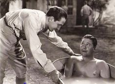 0 bath time - Fredric March talking to  Jack Oakie who is in his bath in The Eagle and the Hawk (1933)