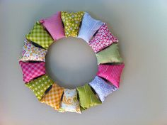 fabric wreath...I love this, it reminds me of bean bags we used to have at school.