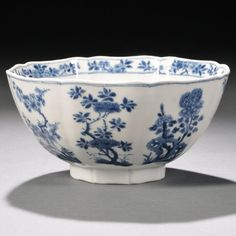 Blue and White Bowl, China, possibly Qing Dynasty, of octagonal lobed form, the exterior depicting various floral sprays on each panel, including chrysanthemums, peonies, prunus blossoms, rhododendrons, and carnations, six-character Xuande mark on base, ht. 3 1/2 in.
