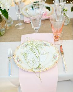 Such a sweet setting: Pale pink, florals, and baby's breath.