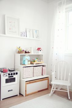 white playroom. I am finding I really prefer the clean look of white for a playroom/classroom area.