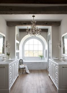 I would want a matching chandelier over the tub too... my vintage soon to be white pedestal tub. Beautifully done bath...Montecito | Ryan Street & Associates