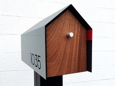 The perfect mailbox design to accent any home.Made in the USA by local . Cool Mailboxes, Custom Mailboxes, Wooden Mailbox, Diy Mailbox, Farmhouse Mailboxes, Mailbox Stand, Home Economics, House Numbers, Home Remodeling