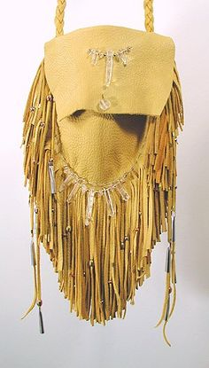 """Quartz Crystal Medicine Bag. This large deerskin bag by Cynthia Whitehawk has double fringe all the way around. Dimensions: 5 1/2"""" x 6"""" functional size of bag; 10"""" x 12"""" with fringe extended. Hand braided neckstrap is an integral part of the bag's stitching line, so it is not reliant on the top flap for strength in carrying. Polished clear quartz points; nickel and copper beads & cones."""