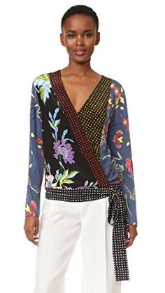 fed4b647d21605 Floral and dot prints bring vivid contrast to this DVF blouse