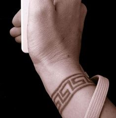 The Greek key tattoo is a popular design in both the world of tattoos and ancient Grecian design. To many in the Ancient Greek world, the pattern is rumored . Thumb Tattoos, Key Tattoos, Cover Up Tattoos, Line Tattoos, Body Art Tattoos, Tatoos, Band Tattoos For Men, Arm Band Tattoo, Tattoos For Guys