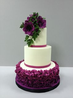 Purple Wedding Cake - See more designs at KnockShoppe.com #weddingcakes