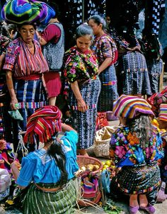 Rainbow - chichicastenango, Quiche #Guatemala-Photographer's Note  The Wednesday market of Chichicastenango, a town relatively close to the beautiful Lake Atitlan, became an importan tourist attraction - but fortunately it is still mainly a market of local people, coming here to satisfy their everyday needs. As I have learnt, the colours and the patterns of the women's dresses indicate the village they come from.