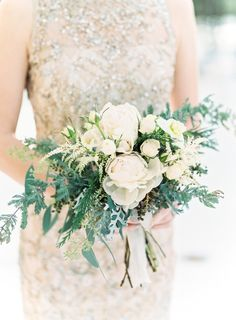 Winter white bridesmaid bouquet: http://www.stylemepretty.com/colorado-weddings/golden-co/2016/05/05/how-this-brides-childhood-home-inspired-her-winter-wedding/ | Photography: Lisa O'Dwyer - http://www.lisaodwyer.com/