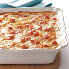 Scalloped Potatoes with Ham ~ Wonderful comfort food for a potluck or holiday party ~ Everyone will love this comforting casserole packed with cheesy red potatoes and ham. It's so delicious and creamy, it'll have them coming back for seconds.  Serves 10.