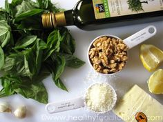 A handful of basil. A bag of walnuts. Some olive oil, garlic, Parmesan cheese. The makings of a tasty pesto. Yum.