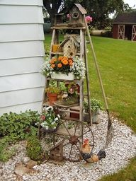 Very cute idea - I've used a ladder as a plant stand in my greenhouse.