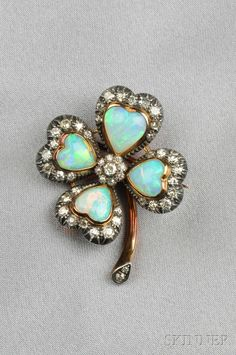 FINE JEWELRY - SALE 2601B - LOT 298 - ANTIQUE OPAL AND DIAMOND CLOVER BROOCH, SET WITH HEART-SHAPE OPALS AND OLD MINE- AND OLD SINGLE-CUT DIAMONDS, SILVER-TOPPED GOLD MOUNT, - Skinner Inc