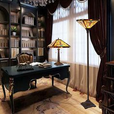 A Tiffany table lamp and a Tiffany floor lamp provide some color to this study.