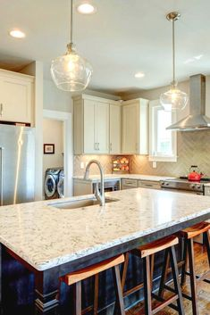 Antique cream kitchen cabinets and large center island. Cream Kitchen Cabinets, Glass Backsplash Kitchen, Glass Kitchen, Kitchen Colors, Kitchen Backsplash, New Kitchen, Kitchen Small, Backsplash Ideas, Kitchen Reno
