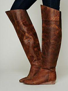 These great over the knee boots have a vintage leather feel and feature elastic gussets behind the knee, stacked leather mini wedge, and zip...