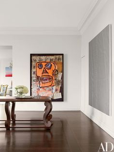 Vicente Wolf Refreshes a Prewar Manhattan Apartment With Eclectic Art Photos | Architectural Digest | large abstract figurative painting | artwork in a hallway | room with high ceiling and tall artwork | contemporary residential interior design ideas