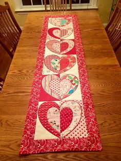 Machine embroidery design for a patchwork table runner with all the blocks made in the 5x7, 6x10 and 8x12 hoops. Full photo instructions are included.
