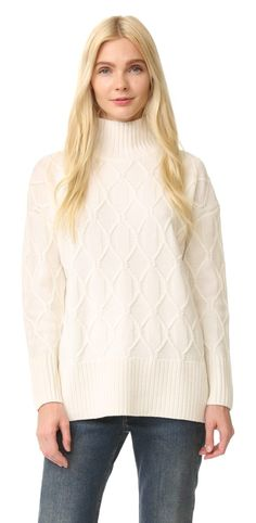 the sweetie sweater by AYR. An oversized AYR sweater, detailed with an elaborate lattice design. Wide ribbed turtleneck and matching edge trim. L...