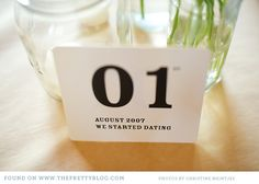 Wedding table markers with little anecdotes about the couple. LOVE.