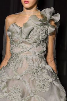 detail+valentino5.jpg (620×933) -- I've seen silk ribbon flowers embellishing vintage clothing before, but I like the monochromatic look of this. That ruffle across the top is accomplished by doing a rolled hem over a nylon fishing line. The nylon doesn't bend or fold, so the ruffle keeps its shape.