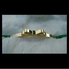 BCBG Bow Belt Beautiful deep green BCBG bow belt. 37 inches from end to end. Thin belt; front faced gold buckle. Never worn excellent condition. BCBGMaxAzria Accessories Belts