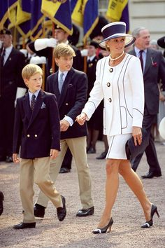 Princes William and Harry with their late Mother,Diana.