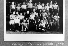 Lodz, Poland, A group photograph before the journey to Eretz Israel, 1947.   Belongs to collection: Yad Vashem Photo Archive   Additional Information: Children of Kibbutz Lodz after the war. The album depicts daily life, religious life, the children and their counselors. The album was presented as a gift to William Bein, by the staff of the Joint Distibution Committee.