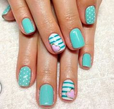 Blue nail with dots,plan blue nails and white nail with straps with a pink nail.