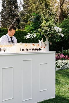 Inside a pretty Melbourne garden wedding: A bar served cocktails and champagne straight after the ceremony.