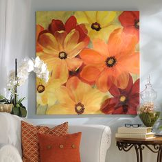 Bring joy into your home with the Sunshine Splash Canvas Art Print! It's bright colors of orange, yellow and red combined with the large blooming flowers make this piece a must-have for summer! Buy it for $35 on 6/17 only.