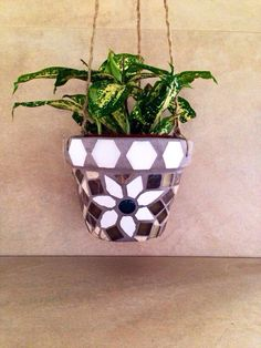 A personal favorite from my Etsy shop https://www.etsy.com/listing/247788666/mosaic-hanging-planter-succulent-pot-air