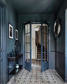 Dark hallway inspiration with tiled floorsYou can find The doors and more on our website.Dark hallway inspiration with tiled floors House Design, Interior Design, House Interior, Interior Design Blog, Home, Interior, Trending Decor, Hallway Inspiration, Colorful Interiors