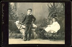 Two children with goat-drawn cart